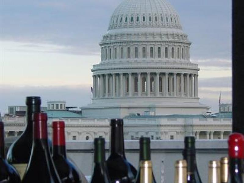 Wine bottles set against the backdrop of the U.S. Capitol.